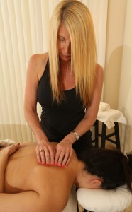 Trigger Point Therapy by a massage therapist on a client