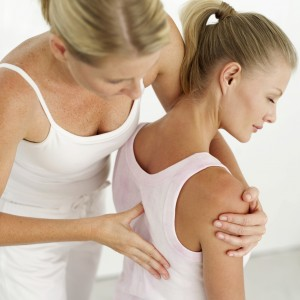 Massage therapist giving therapeutic massage therapy